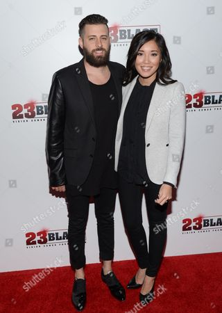 """Producer Brent Ryan Green and his wife Trang Green attend the premiere of """"23Blast"""" at the Regal Cinemas E-Walk Theater on in New York"""
