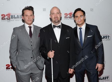 "Actor Mark Hapka, left, the real life inspiration for the film, Travis Freeman and actor Bram Hoover attend the premiere of ""23Blast"" at the Regal Cinemas E-Walk Theater on in New York"