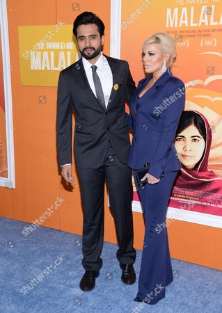 "Actor Jackky Bhagnani, left, and girlfriend attend the premiere of ""He Named Me Malala"" at The Ziegfeld Theatre, in New York"