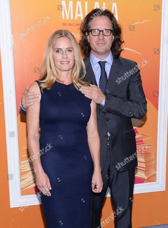 """Elizabeth Shue and husband, director Davis Guggenheim, attend the premiere of """"He Named Me Malala"""" at The Ziegfeld Theatre, in New York"""