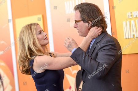 """Stock Image of Elizabeth Shue and husband, director Davis Guggenheim, attend the premiere of """"He Named Me Malala"""" at The Ziegfeld Theatre, in New York"""