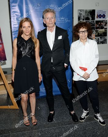 """Sandra Brant, left, Calvin Klein and Ingrid Sischy attend a special screening of """"Rear Window"""", hosted by The Princess Grace Foundation, at The Academy Theater, in New York"""