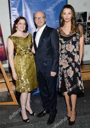 "Stock Photo of Princess Grace Foundation executive director Toby Boshak, left, Paul Haggis and guest attend a special screening of ""Rear Window"", hosted by The Princess Grace Foundation, at The Academy Theater, in New York"