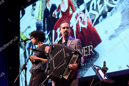 """Singer Raya Yarbrough, left, and composer Bear McCreary perform onstage at the Television Academy's member event, Starz' """"Outlander: From Scotland to Paris,"""" at NYU Skirball Center for the Performing Arts on in New York"""