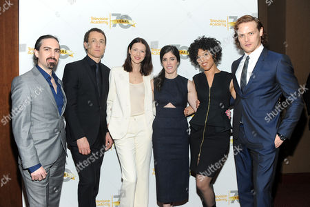 """From left, composer Bear McCreary, actors Tobias Menzies and Caitriona Balfe, executive producer Maril Davis, singer Raya Yarbrough and actor Sam Heughan are seen at the Television Academy's member event, Starz' """"Outlander: From Scotland to Paris,"""" at NYU Skirball Center for the Performing Arts on in New York"""