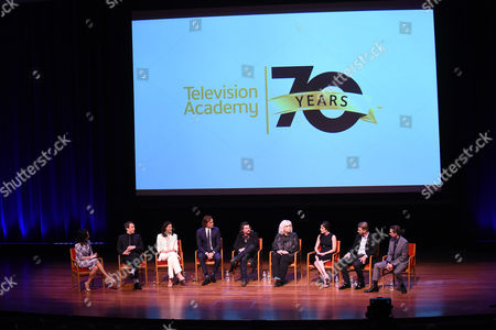 """Stock Picture of From left, Michelle Miller, Tobias Menzies, Caitriona Balfe, Sam Heughan, Ron D. Moore, Terry Dresbach, Maril Davis, Jon Gary Steele, and Bear McCreary speak onstage at the Television Academy's member event, Starz' """"Outlander: From Scotland to Paris,"""" at NYU Skirball Center for the Performing Arts on in New York"""