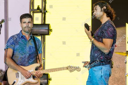 Guitaris Mark Pellizzer, left, and vocalist Nasri Atweh of the band Magic! performs on stage during the Pandora Presents The 2014 Summer Party at The Santa Monica Pier, in Santa Monica, Calif