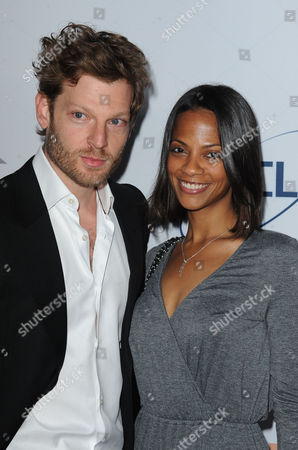 Cicely Saldana, at left, and Jared Lehr arrives at Pathway to the Cure Benefit at Santa Monica Airport, in Santa Monica, CA
