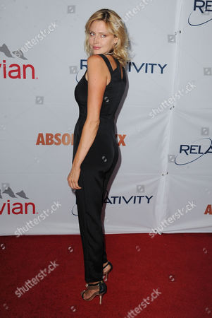 Stock Image of Estella Warren arrives at Pathway to the Cure Benefit at Santa Monica Airport, in Santa Monica, CA