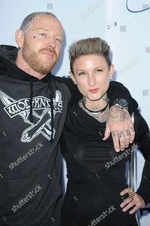 Jason Ellis, at left, and Katie Gilbert arrives at Pathway to the Cure Benefit at Santa Monica Airport, in Santa Monica, CA