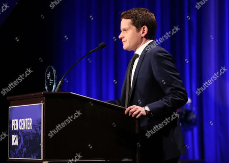 Graham Moore accepts the Screenplay Award for the 'Imitation Game' at the PEN Center USA's 25th Annual Literacy Awards Festival at the Beverly Wilshire Hotel, in Beverly Hills, Calif