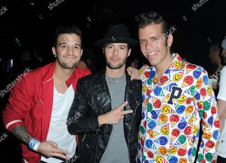 Professional dancer Mark Ballas, left, and Travis Garland, center, pose for a photo with Perez Hilton at his Pajama Birthday Party at the El Rey Theatre on in Los Angeles