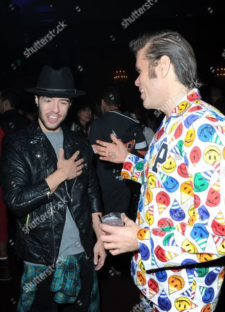 Travis Garland, left, and Perez Hilton are seen at his Pajama Birthday Party at the El Rey Theatre on in Los Angeles