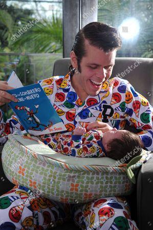 Perez Hilton poses for a photo with his son Mario Armando Lavandeira III at his Pajama Birthday Party at the El Rey Theatre on in Los Angeles