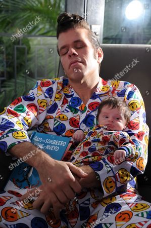 Stock Picture of Perez Hilton poses for a photo with his son Mario Armando Lavandeira III at his Pajama Birthday Party at the El Rey Theatre on in Los Angeles