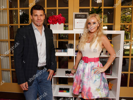 Daivd Boreanaz and Jaime Boreanaz attend the Polish Play and emPower Chrome Girl Nail Lacquer Debut on in Los Angeles