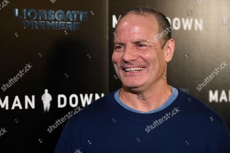 "Director Dito Montiel arrives at the Los Angeles premiere of ""Man Down"" at ArcLight Cinemas Hollywood on"