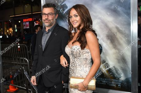 """Andre Nemec, left and Jade Harlow attends The Los Angeles Premiere of """"Project Almanac"""" at the TCL Chinese Theatre, in Los Angeles"""