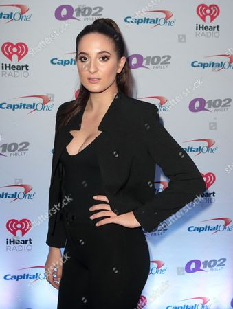 Chloe Angelides poses for photographers backstage during Q102's iHeartRadio Jingle Ball 2015 at the Wells Fargo Center, in Philadelphia