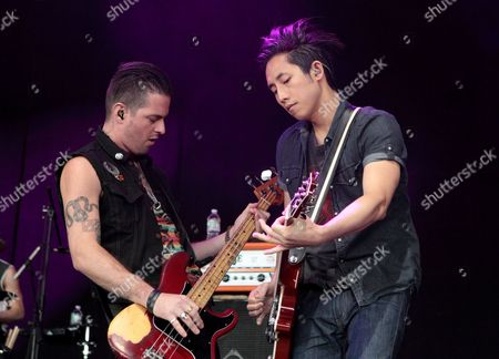 Noah Harmon and Steven Chen of the rock band The Airborne Toxic Event perform on stage during the Radio 104.5 Birthday concert at the Susquehanna Bank Center, in Camden, N.J