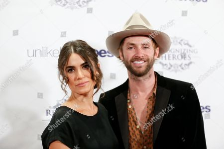 Actress Nikki Reed, left, and husband musician Paul McDonald, right, arrive at the Recognizing Heroes Awards Dinner and Gala at the W Hotel Hollywood on in Los Angeles