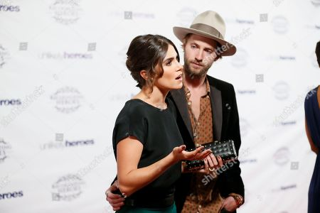 Actress Nikki Reed, left, and husband musician Paul McDonald, right, are interviewed at the Recognizing Heroes Awards Dinner and Gala at the W Hotel Hollywood on in Los Angeles