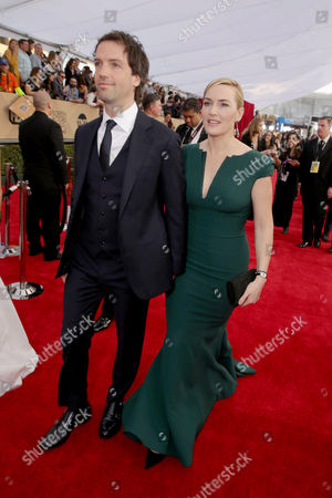 Ned Rocknroll and Kate Winslet seen at Red Carpet arrivals for the 22nd Annual SAG Awards at Shrine Auditorium, in Los Angeles, CA