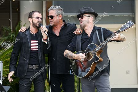 Ringo Starr, from left, Jon Stevens and Dave A. Stewart perform at Ringo Starr's 76th birthday celebration held at Capitol Records, in Los Angeles