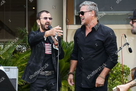Ringo Starr, left, and Jon Stevens perform at Ringo Starr's 76th Birthday Celebration held at Capitol Records, in Los Angeles