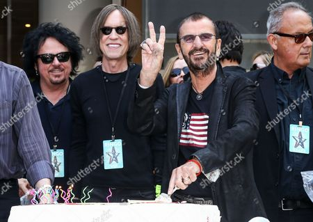 Ringo Starr, second right, appears at his 76th birthday celebration at Capitol Records, in Los Angeles. Looking, from left are, Steve Lukather, Glen Ballard and Smokey Wendell, right
