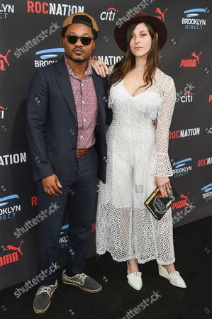 Theo Spielberg, left and Sasha Spielberg arrive at the Roc Nation Pre-Grammy Brunch at RocNation Offices, in Beverly Hills, Calif