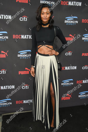 Dani Evans arrives at the Roc Nation Pre-Grammy Brunch at RocNation Offices, in Beverly Hills, Calif