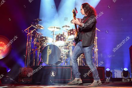 Neil Peart, left, and Geddy Lee of Rush performs during the final show of the R40 Tour at The Forum, in Los Angeles