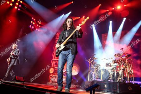 Alex Lifeson, from left, Geddy Lee and Neil Peart of Rush perform during the final show of the R40 Tour at The Forum, in Los Angeles