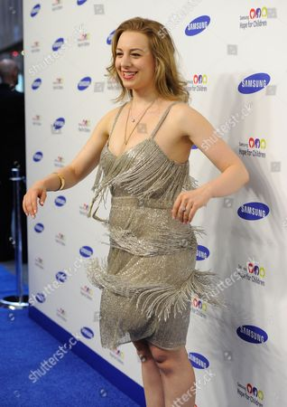 Figure skater Sarah Hughes arrives for the 13th Annual Samsung Hope For Children Gala at Cipriani Wall Street, in New York