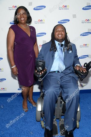 Eric LeGrand and his mother attend the 13th Annual Samsung Hope For Children Gala at Cipriani Wall Street on in New York