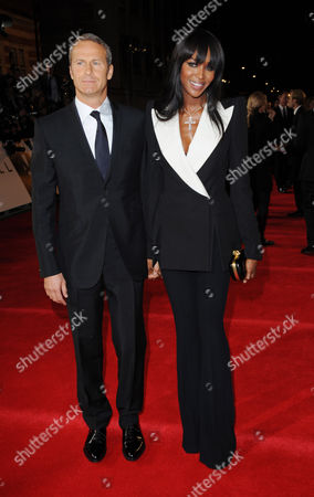 "Russian real estate entrepreneur Vladislav Doronin, left, and model Naomi Campbell arrive at the world premiere of ""Skyfall"" at the Royal Albert Hall on in London"
