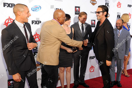 """From left, Theo Rossi, Paris Barclay, Maggie Siff, Charlie Hunnam, Tommy Flanagan and Michael Ornstein arrive at FX's """"Sons of Anarchy"""" Season 6 Premiere Screening and Party, on in Hollywood, Calif"""