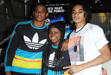 "Corde Broadus, from left, Cori Broadus, and Cordell Broadus attends the Snoop Dogg and The Snoop Youth Football League's special screening of ""Turbo"" at the ArcLight Hollywood on in Los Angeles"