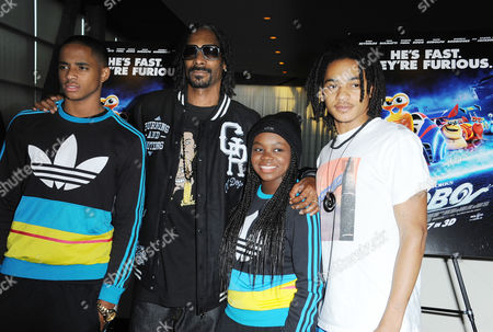 "Stock Image of Snoop Dogg, second from left, and his children, Corde Broadus, Cori Broadus, and Cordell Broadus attend the Snoop Dogg and The Snoop Youth Football League's special screening of ""Turbo"" at the ArcLight Hollywood on in Los Angeles"