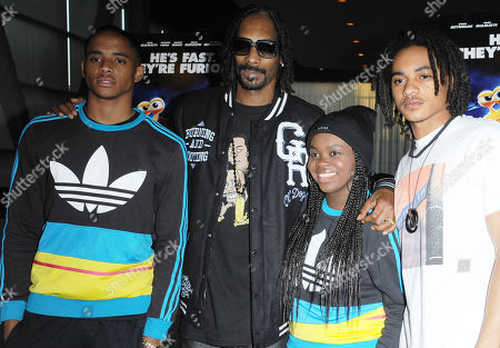 "Stock Picture of Snoop Dogg, second from left, and his children, Corde Broadus, Cori Broadus, and Cordell Broadus attend the Snoop Dogg and The Snoop Youth Football League's special screening of ""Turbo"" at the ArcLight Hollywood on in Los Angeles"
