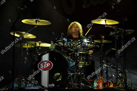 Stock Photo of Eric Kretz of Stone Temple Pilots with Chester Bennington performs at the BB&T Center on in Sunrise, Florida