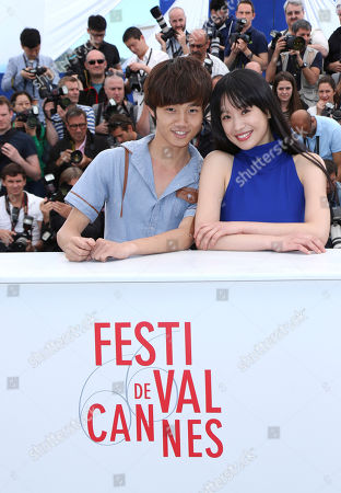 Stock Picture of Actors Meng Li, right, and Lanshan Luo pose for photographers during a photo call for the film Stranger by the Lake at the 66th international film festival, in Cannes, southern France