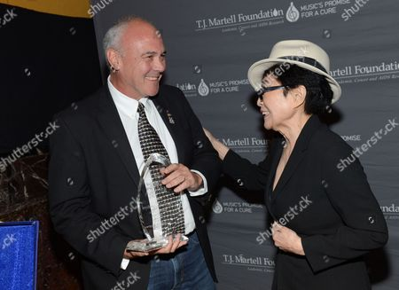 Hard Rock International President and CEO Hamish Dodds, left, receives the Spirit of Excellence Award from Yoko Ono at the T.J. Martell Foundation's 39th Annual New York Honors Gala at Cipriani 42nd Street on in New York