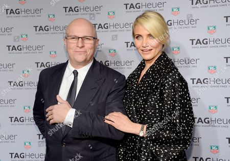 Tag Heuer CEO, Stephane Linder and actress Cameron Diaz pose together at the Tag Heuer flagship store opening on in New York