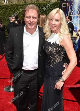 Sig Hansen and June Hansen arrive at the Television Academy's Creative Arts Emmy Awards at the Nokia Theater L.A. LIVE, in Los Angeles
