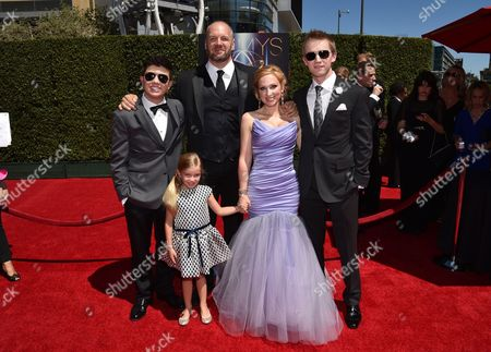Bradley Steven Perry, and from left, Eric Allan Kramer, Leigh-Allyn Baker, Jason Dolley and guest arrive at the Television Academy's Creative Arts Emmy Awards at the Nokia Theater L.A. LIVE, in Los Angeles