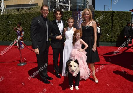 """Stock Picture of Regan Burns, and from left, Blake Michael, G. Hannelius, Francesca Capaldi, Beth Littleford and dog from """"Dog with a Blog"""" arrives at the Television Academy's Creative Arts Emmy Awards at the Nokia Theater L.A. LIVE, in Los Angeles"""