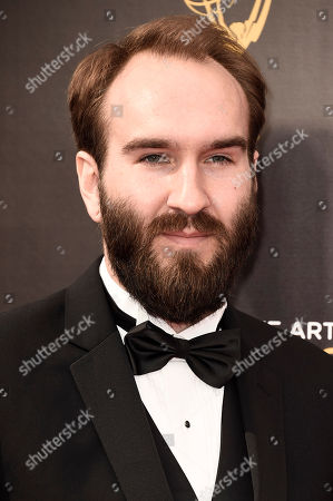 Stock Photo of Eric Demeusy arrives at night one of the Television Academy's 2016 Creative Arts Emmy Awards at the Microsoft Theater on in Los Angeles