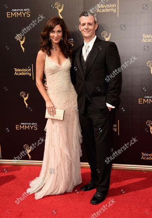 Jama Williamson, left, and Curtis Mark Williams arrive at night one of the Television Academy's 2016 Creative Arts Emmy Awards at the Microsoft Theater on in Los Angeles